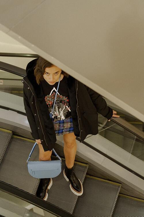 Christopher Kane hoodie; Alexander Terekhov jacket; Burberry bags; Stella McCartney shoes